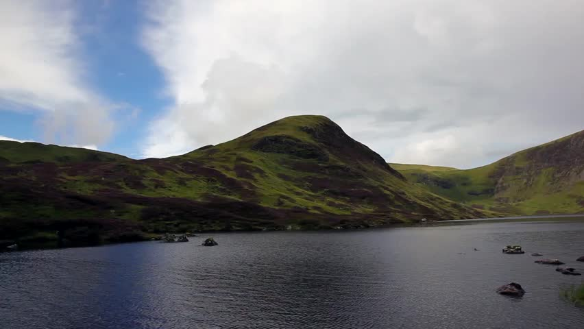 A lake surrounded by hills in Scotland - HD stock footage clip