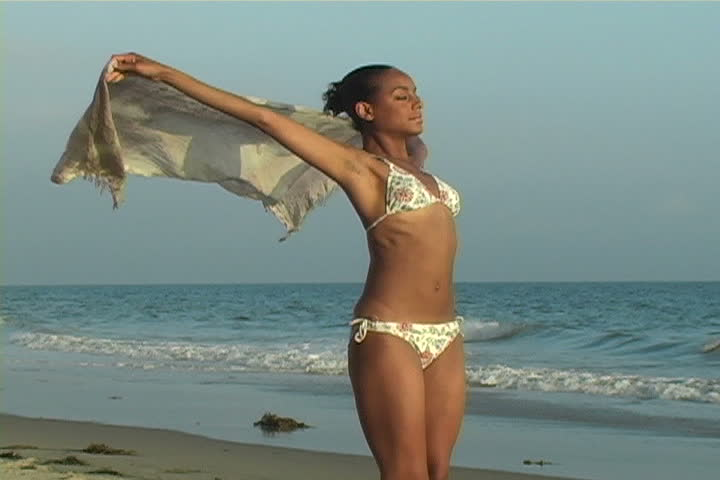 A woman with pareo fluttering in the wind.   - SD stock video clip