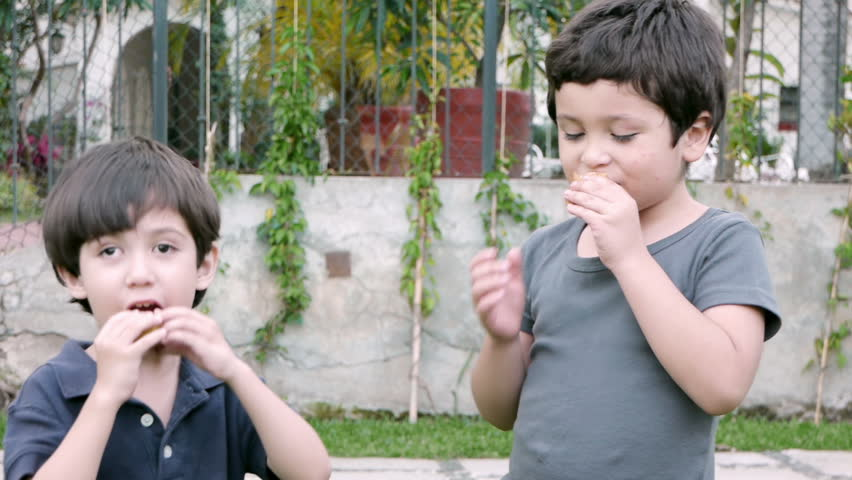 Boys Share Twinky Cake (HD). Two brothers of Hispanic origin; six and four years old share and eat a twinky cake. Note: The younger Brother on the left suffers from a slight Lazy eye problem.