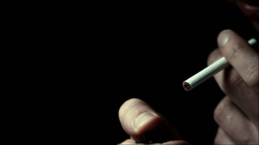 Man lights a cigarette lighter in slow motion