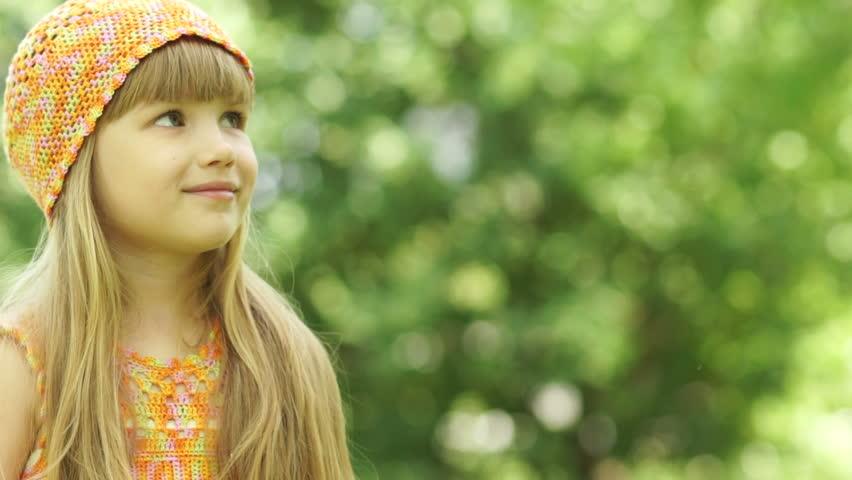 3s girl blowing a dandelion. Close-up portrait. - HD stock footage clip