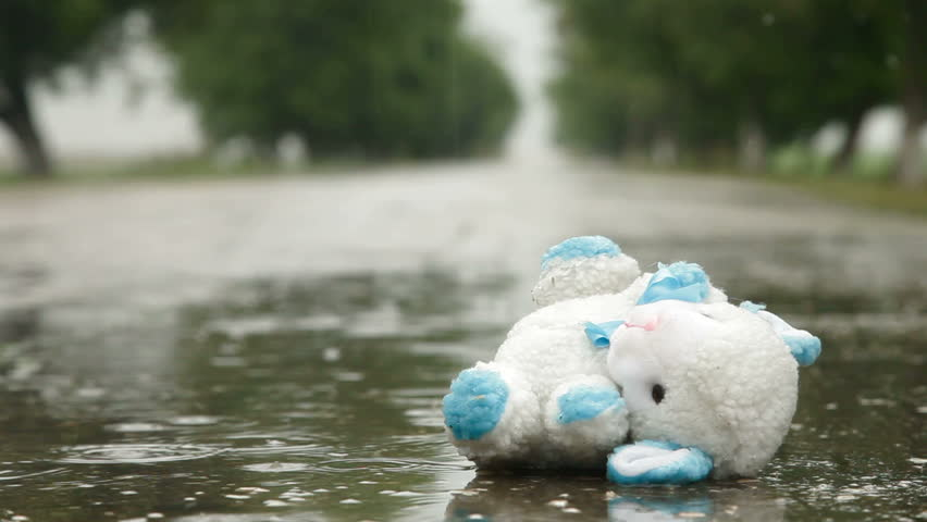 Lost Toy In A Puddle Under Rain, Surface Level