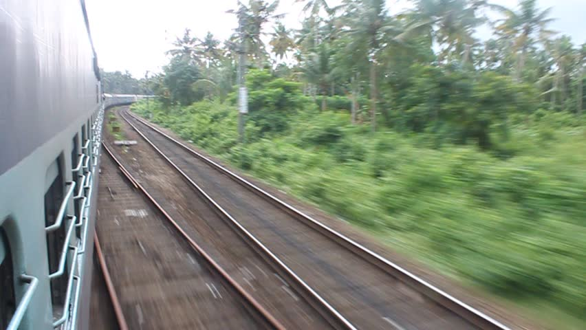 Scene from moving train, South India - HD stock footage clip