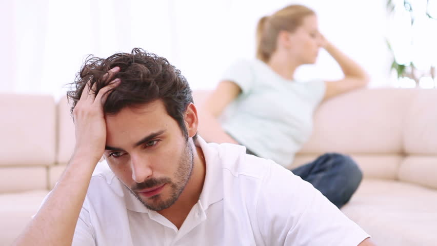 Young couple are upset after a fight in their living room - HD stock video clip