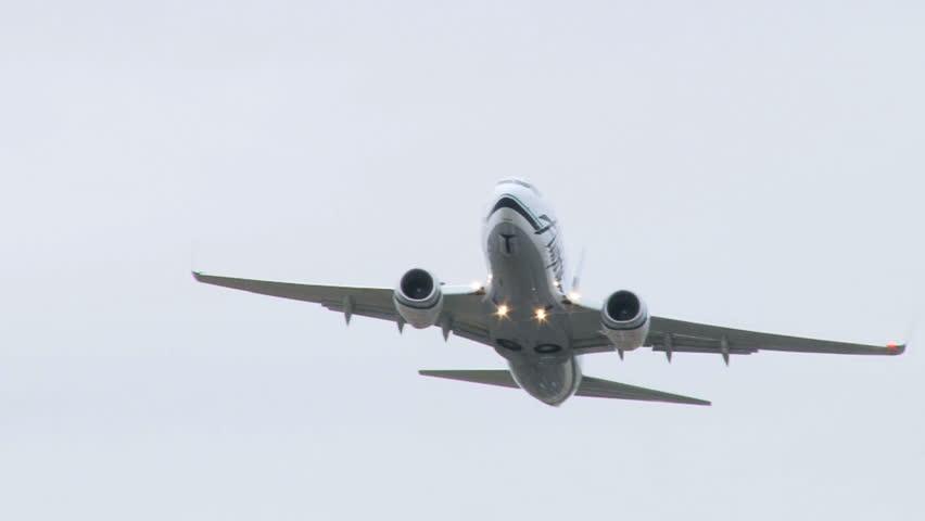 PORTLAND, OREGON, USA - CIRCA FEBRUARY 2010: Airplane takes off at Portland