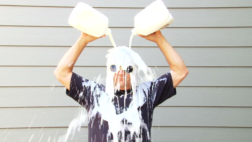 Got Milk anyone? Humorous clip of man pouring two gallons of milk over his head.