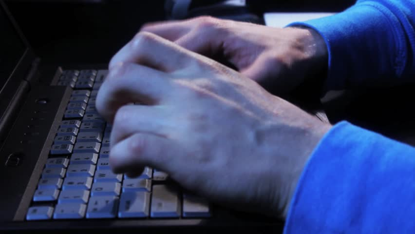Close up of fingers tying on a laptop - HD stock footage clip