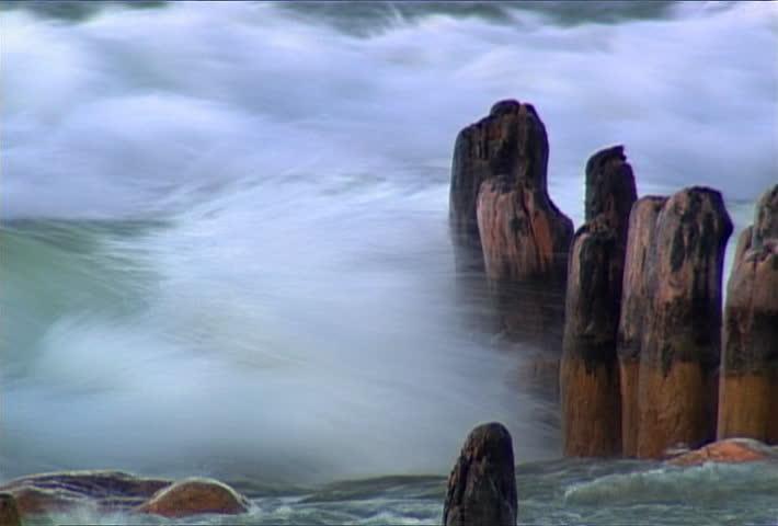 Waves break around pilings