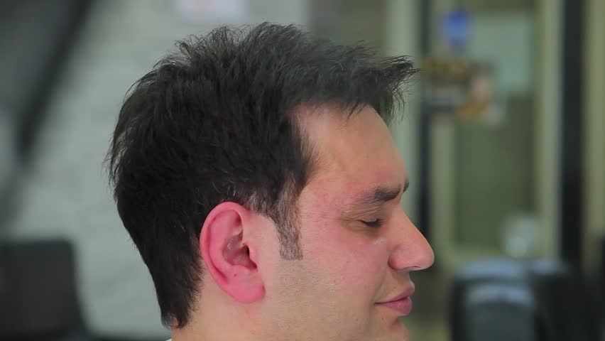 man gets haircut 1 - HD stock footage clip