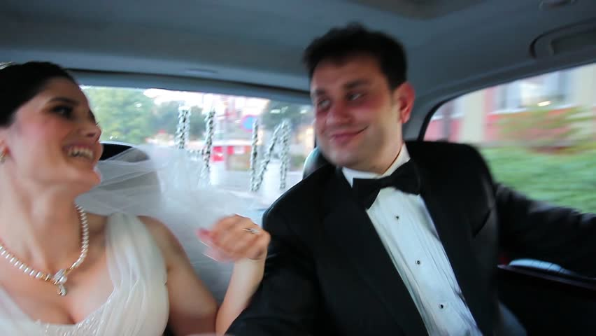 bride and groom dance in the car  - HD stock video clip