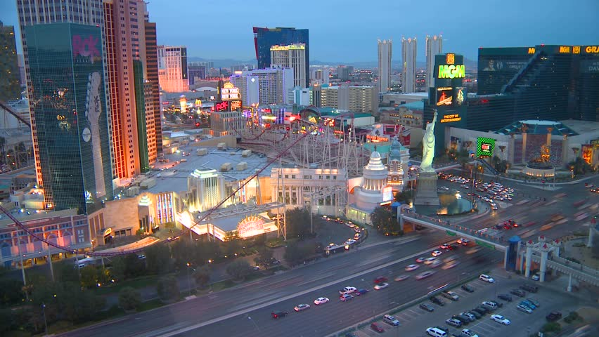 LAS VEGAS - CIRCA 2011: Aerial time lapse of the strip from dusk to night time.
