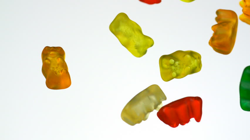 Colorful gummy bear falling in the air shooting with high speed camera, phantom flex. - HD stock footage clip