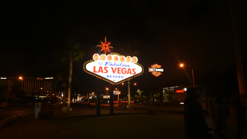 Time lapse of people taking pictures against world famous  Las Vegas city welcome sign. | Shutterstock HD Video #24237257