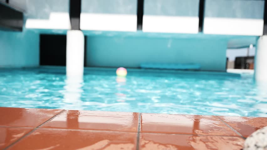 Beautiful woman having fun in a resort swimming pool, relaxing in the water and sunbathing | Shutterstock HD Video #24240866