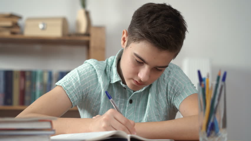 Teenager tired of doing lessons, thinking | Shutterstock HD Video #24240992