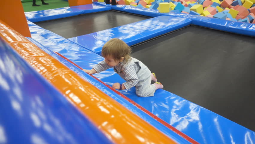 The One Year Old Baby Cute Playing In Indoors Playground. Active Toddler Boy Having Fun At Sport Center. Slow Motion   Shutterstock HD Video #24245375