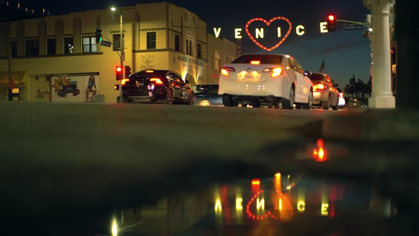 LOS ANGELES - February 14, 2017: Traffic at night under the famous iconic Venice sign decorated with red heart to celebrate Valentine's Day at Venice Beach, California. | Shutterstock HD Video #24251594