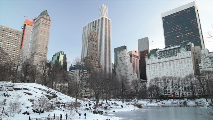 People in snowy Central Park New York City winter, high rise towers | Shutterstock HD Video #24252251