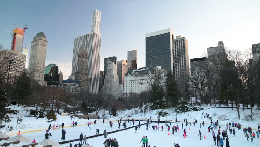 People in snowy Central Park New York City winter, high rise towers | Shutterstock HD Video #24252296
