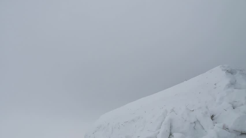 Snowboarder jumping in the mountains in the snow winter sport winter. Snowboarder   Shutterstock HD Video #24258659