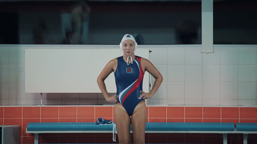 Woman water polo player in white cap blue swimsuit with russian symbols jump into sports inside swim pool   Shutterstock HD Video #24273059