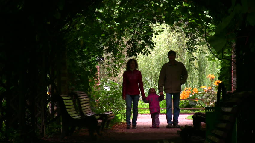 family silhouette in plant tunnel  - HD stock video clip