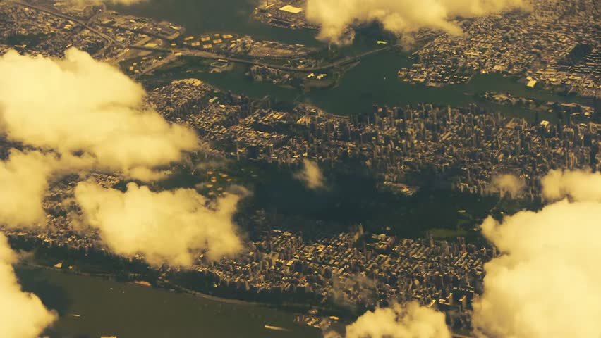 Aerial view of Manhattan, New York City USA as seen from a commercial aircraft on a partly cloudy day  #24382571