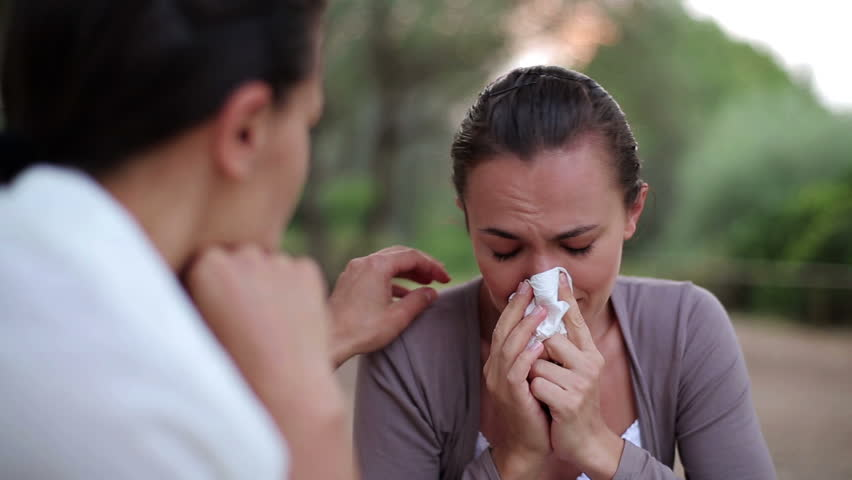 Female friend comforting sad woman, outdoor  - HD stock footage clip