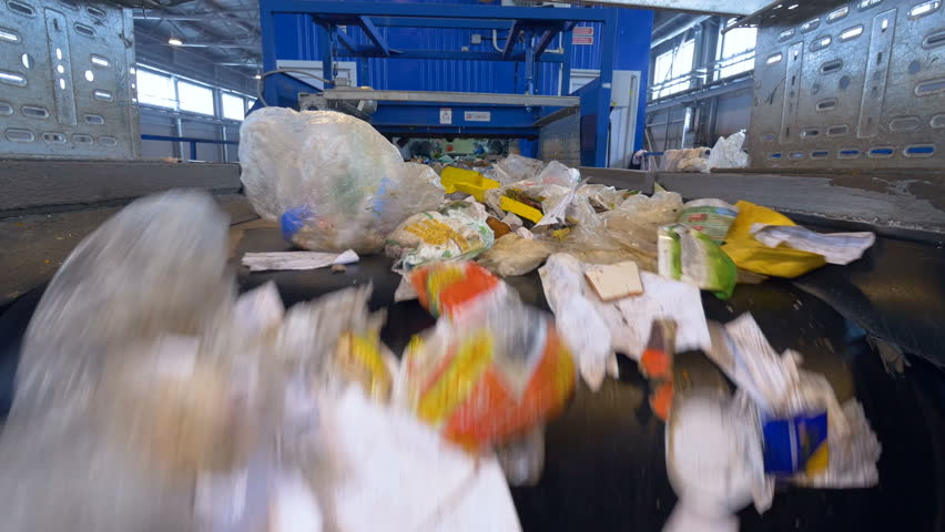 Garbage sorting conveyor on a waste recycling plant.