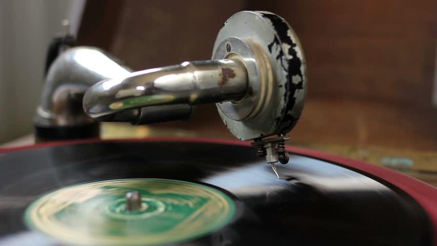 Vintage gramophone playing music from black vinyl