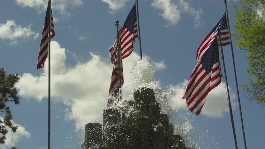 Fountains, American Flags, & Puffy Clouds - HD stock video clip