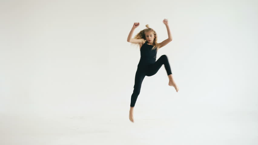 Modern beautiful teenage girl dancer dancing contemporary on white background indoors | Shutterstock HD Video #24523592