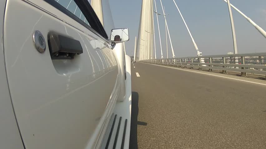 White car goes over the bridge | Shutterstock HD Video #24546146