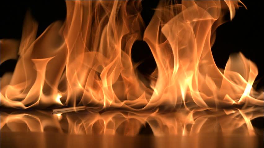 Falling matchstick lights a flammable liquid