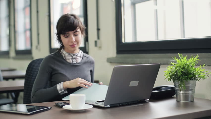 Businesswoman with documents and laptop in office  - HD stock video clip
