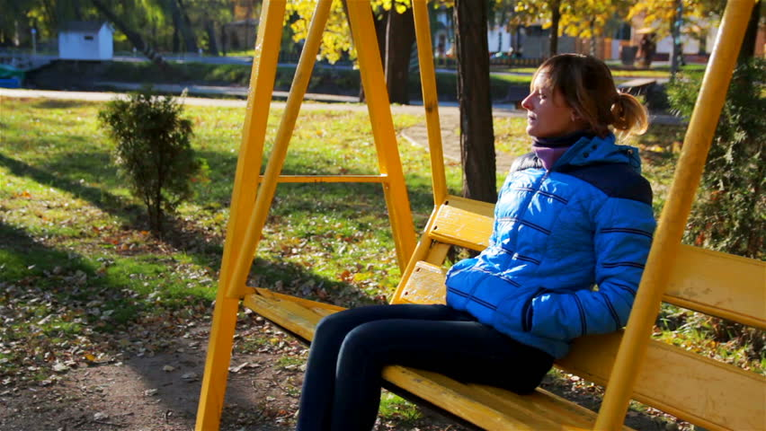 Young Woman on Swing in Sunny Autumn Day  | Shutterstock HD Video #24654452