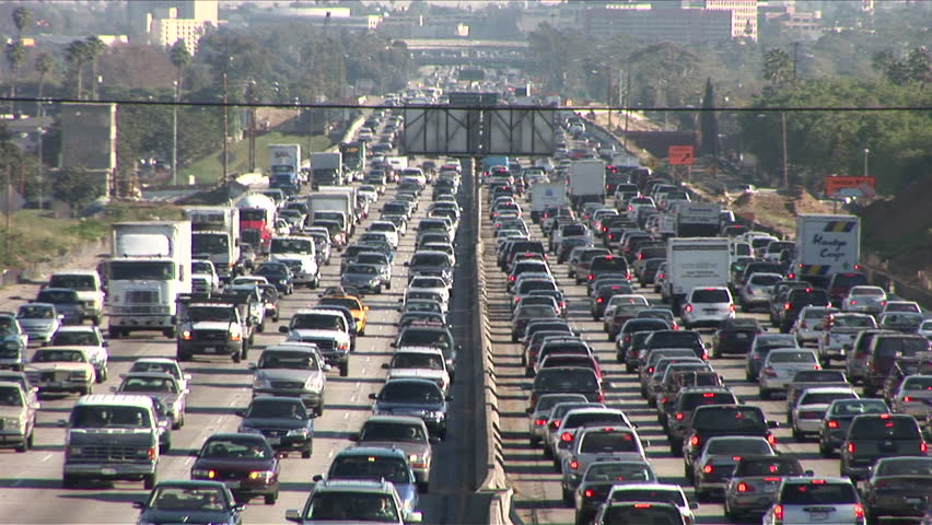 Los Angeles, CA - CIRCA February 2006: Sitting in the hot California sun on the traffic riddled freeway, blasting the air conditioner and grooving to the radio, is the official state past time.
