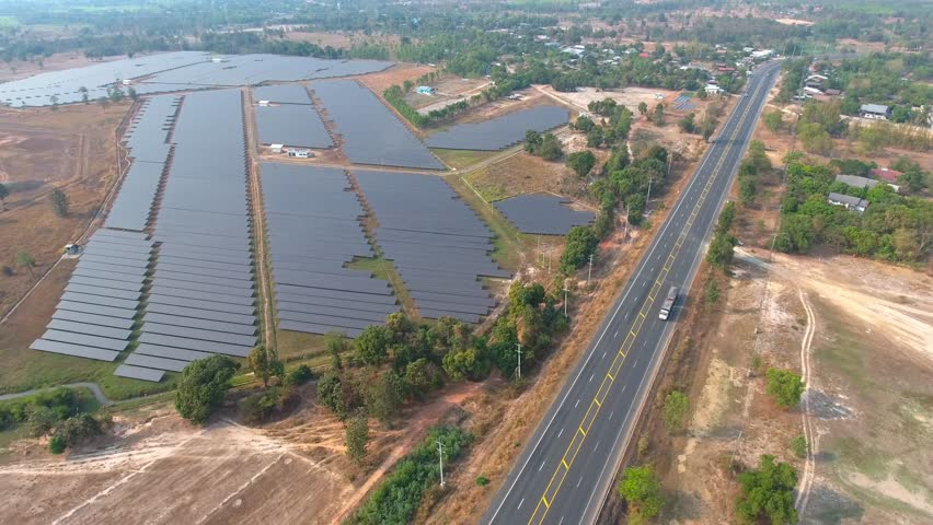Aerial view large industrial Solar Energy Farm producing concentrated solar energy. Solar Energy Farm at Thailand  | Shutterstock HD Video #24784673