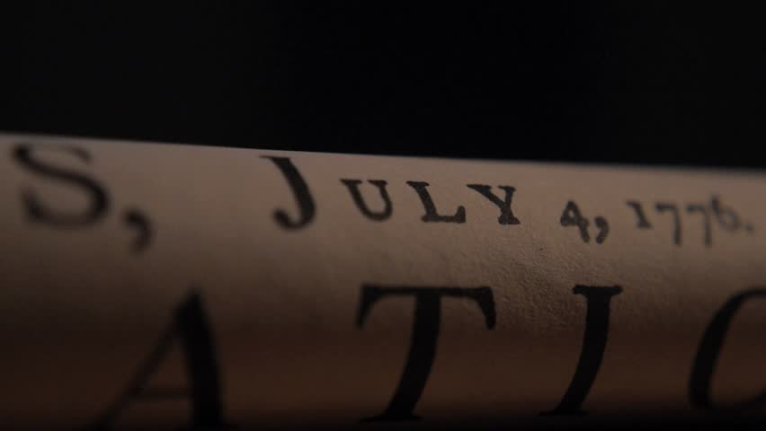 VIRGINIA - SUMMER 2016 - Reenactment, Founding Fathers, American Revolutionary War recreation -- rolled copy of document, Declaration of Independence rolled on table of Tavern in 1700s. July 4, 1776