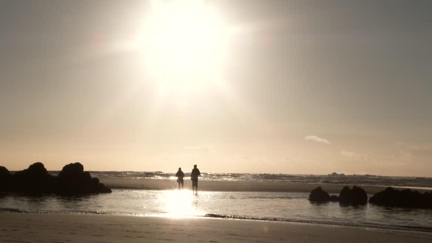 Couple enjoy a sunny day at the beach on sandbar along the Oregon Coast. #24870326