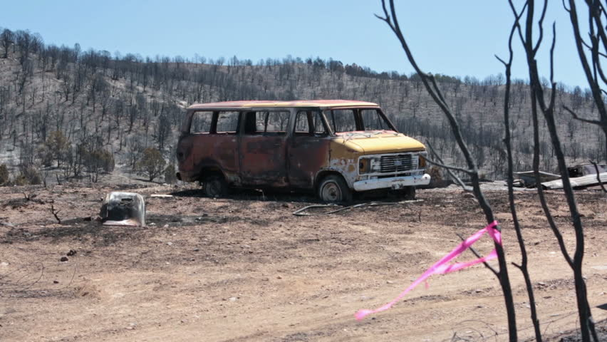 Home and vehicle destroyed by wildfire. Charred and burnt homes and business. Destructive blaze destroyed dozens of homes. Wood Hollow Utah. Drought with strong summer winds. - HD stock video clip