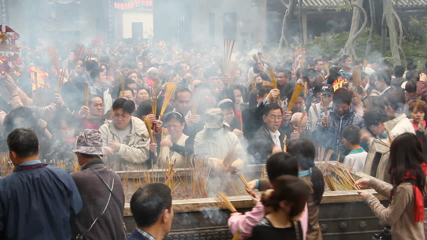 GUANGZHOU - FEBRUARY 3: People burn incense in temple during Chinese New Year on