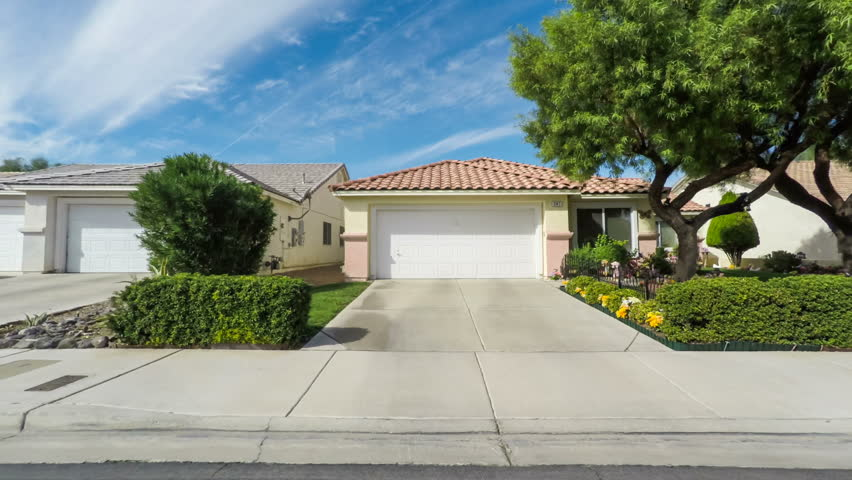 Driving through a southwestern USA suburban neighborhood on a sunny day | Shutterstock HD Video #24951362