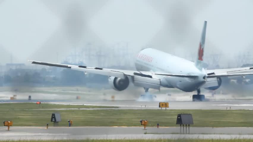 Toronto, Ontario JUNE 18th: Jet landing at Pearson International airport in Toronto on June 18th, 2012. Pearson International is the busiest airport in Canada.