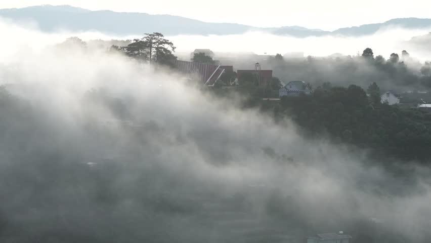 DA LAT, VIETNAM, Sep 23, 2015: pine forest, highland Da Lat city fog in the morning | Shutterstock HD Video #25001780