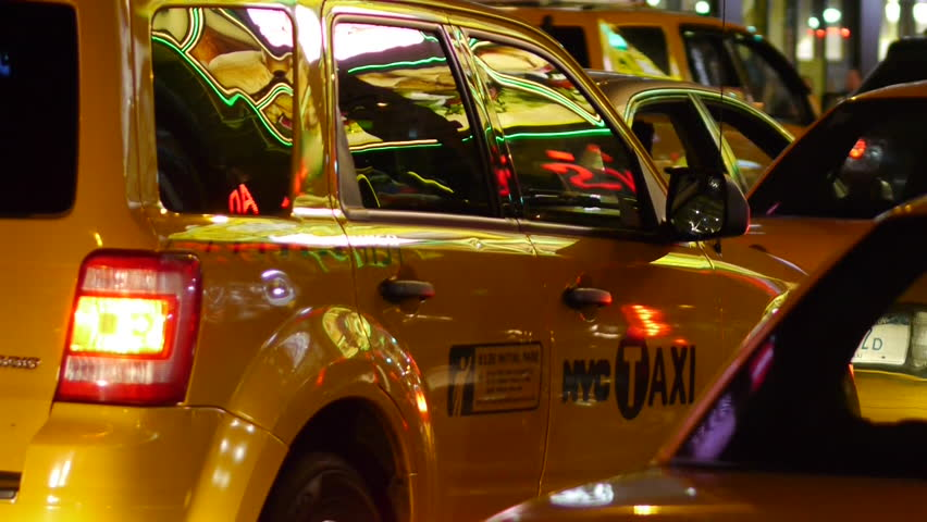 Yellow Cabs window glass glare of neon lights in New York City - HD stock video clip