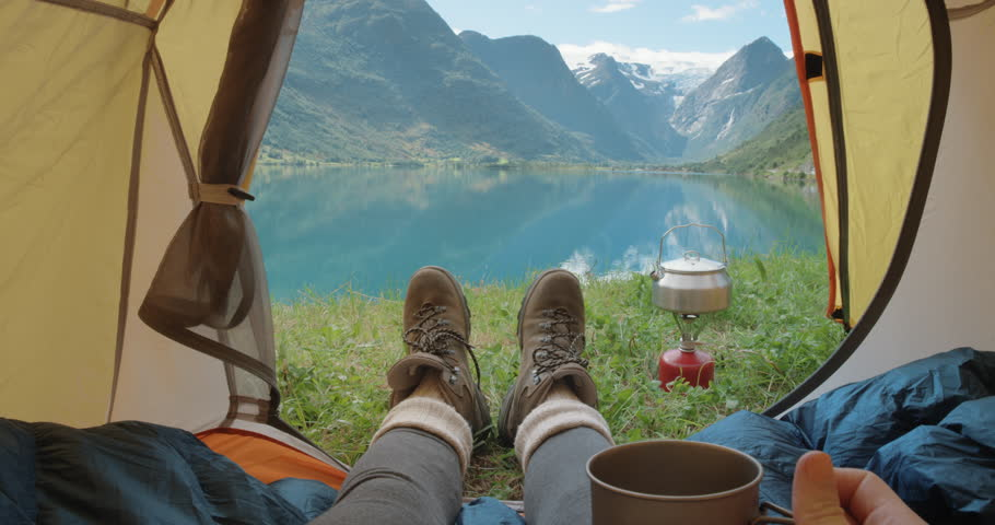 Camping woman lying in tent Close up of Girl feet wearing hiking boots relaxing on vacation POV | Shutterstock HD Video #25095542