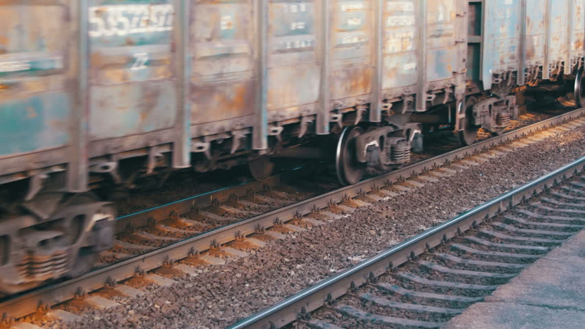 Freight train traveling on the railroad. Heavy train moves on rails.   Shutterstock HD Video #25115144