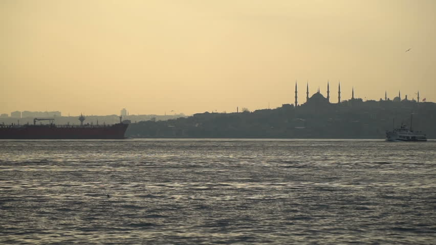 A tanker and a transportation ship are passing by The Istanbul Bosphorus at slow motion.   Shutterstock HD Video #25125098