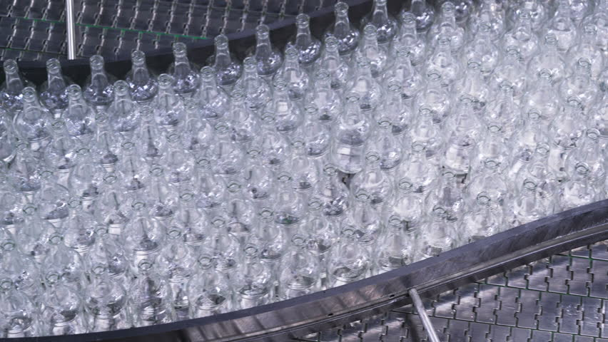 Bottles on conveyor belt in factory. Bottle manufacturing technology in industrial factory. empty beer glass on the transporter   Shutterstock HD Video #25134935